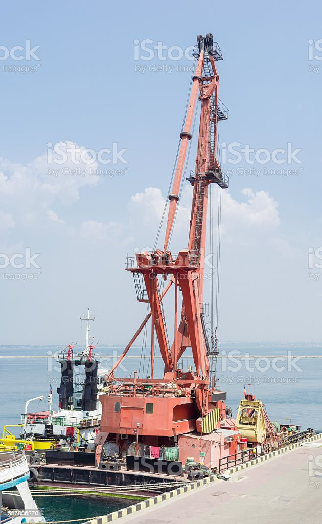 Floating crane at the seaport berth stock photo