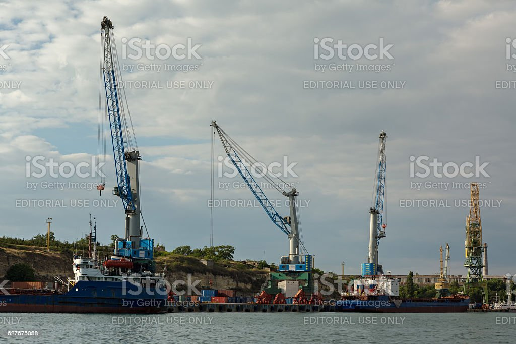 Floating cranes lift trucks in the Bay of Black Sea. stock photo