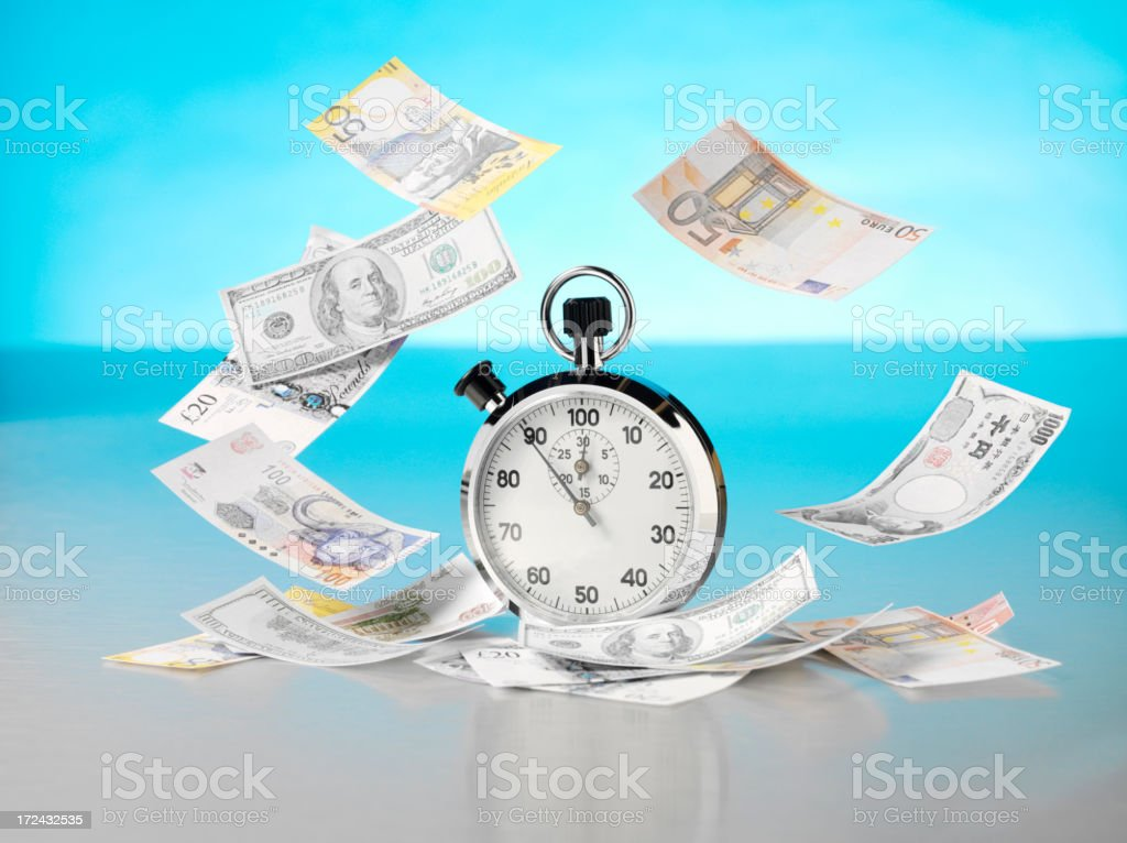 Floating Dollars, Euros and Pounds around a Stopwatch royalty-free stock photo