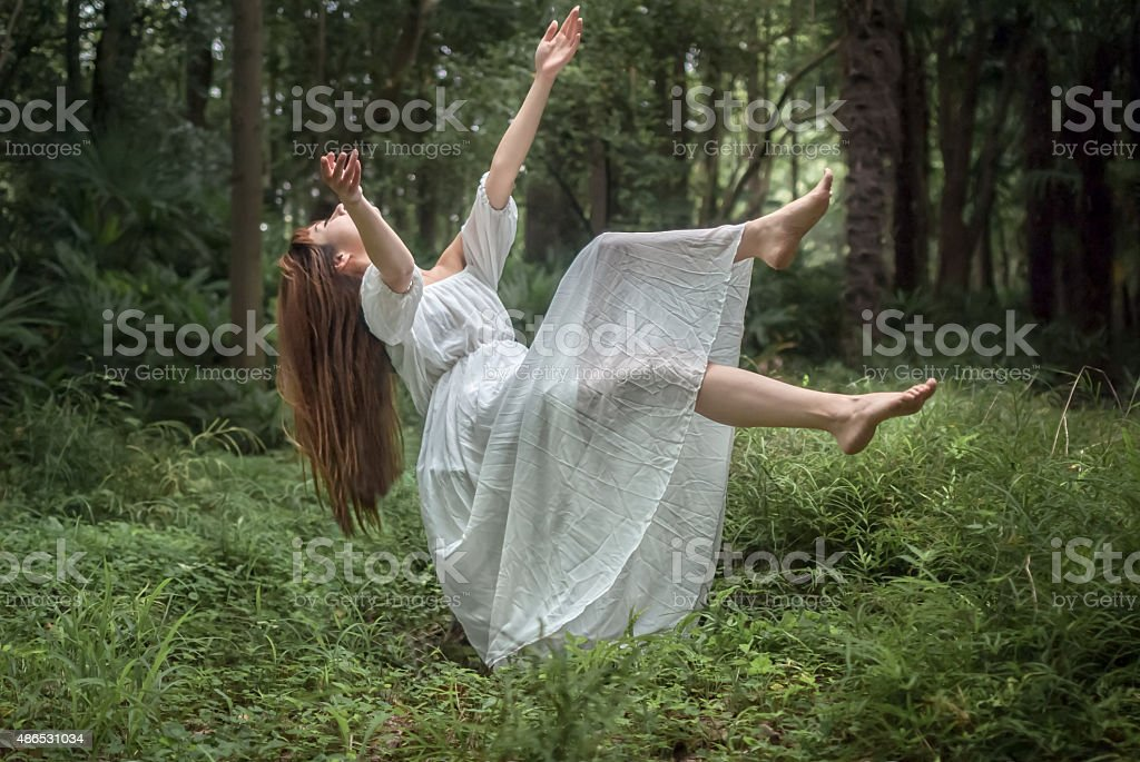 Floating Girl in the Forest stock photo