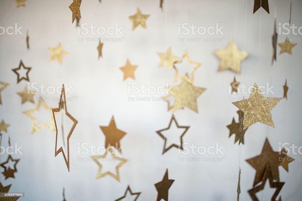 Floating golden stars stock photo