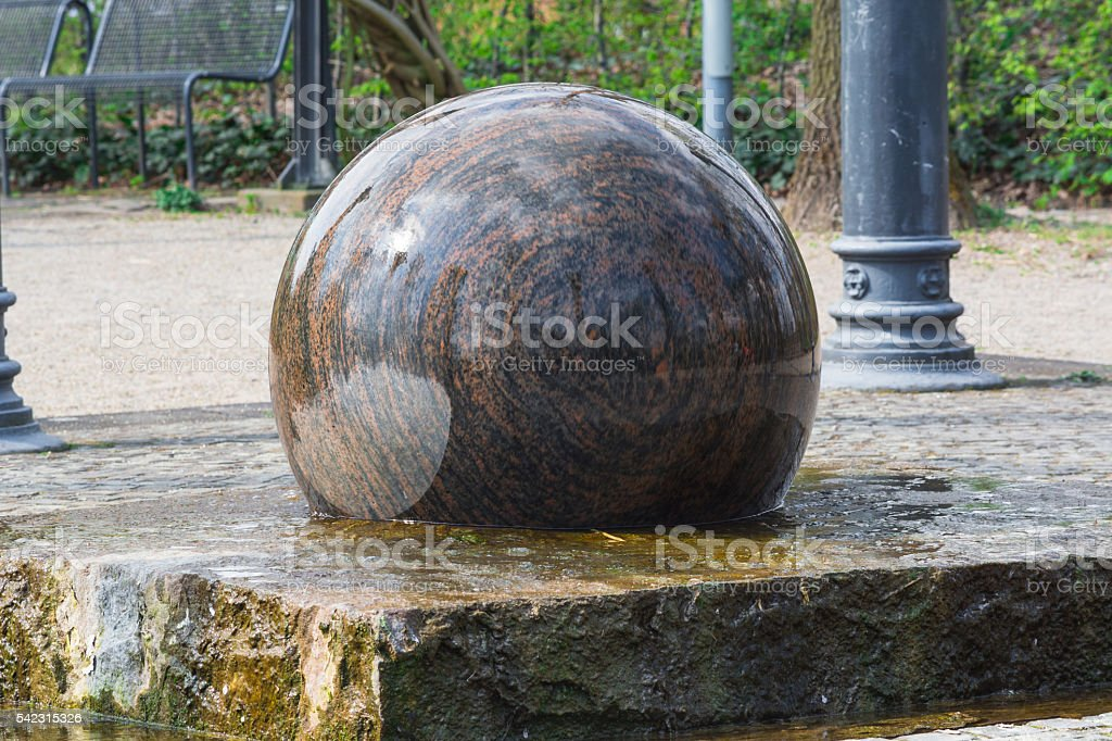 Floating Granite sphere as Fountain stock photo
