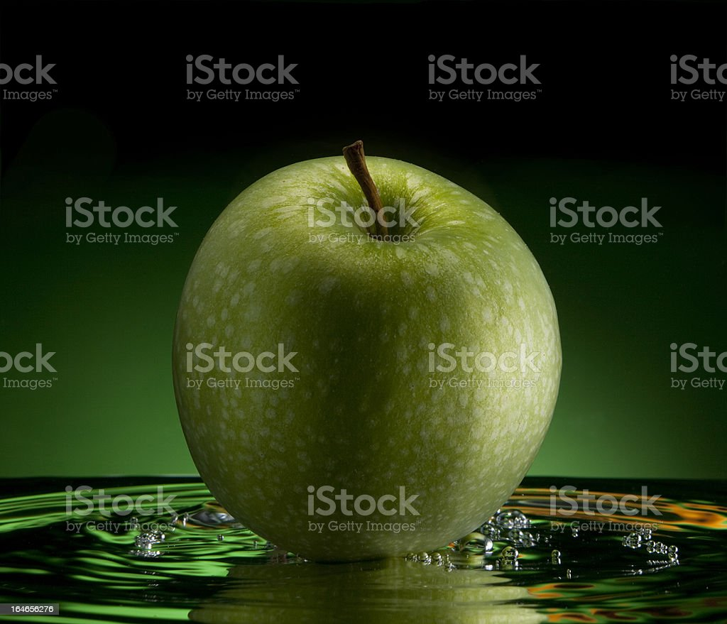 Floating green apple royalty-free stock photo