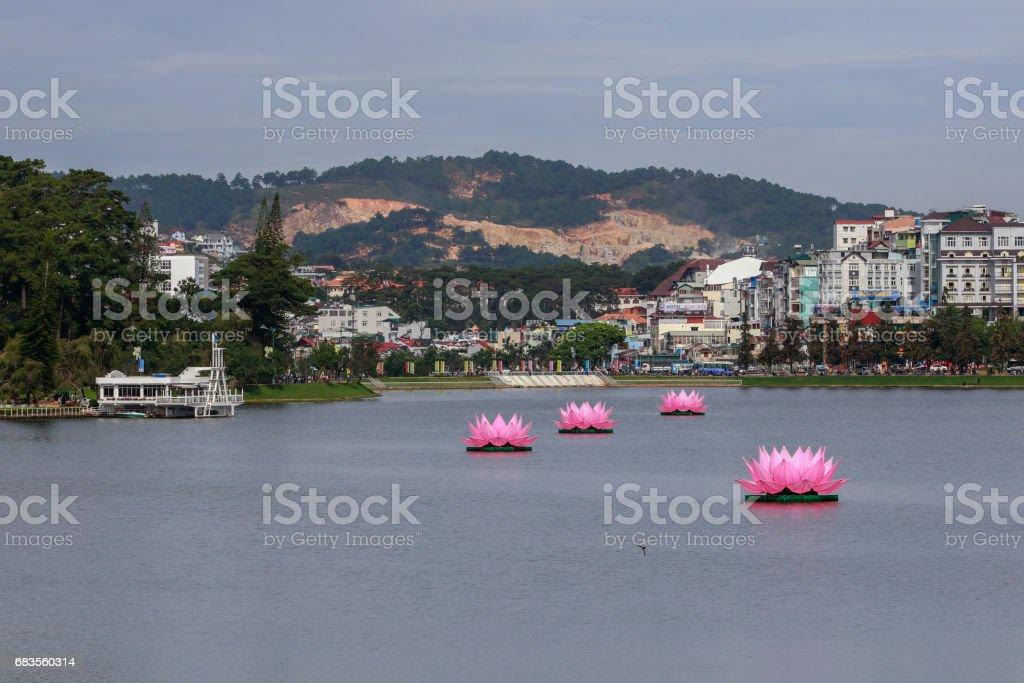 Floating handmade lotus in lake during Buddha birthday in Vietnam stock photo