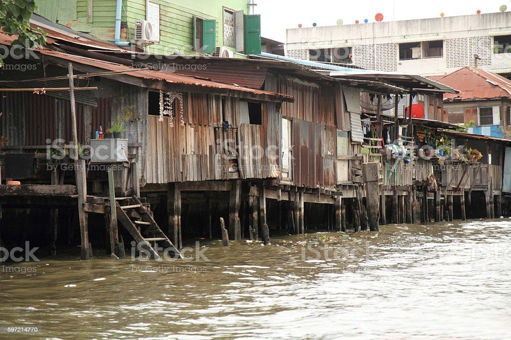Floating house on Chaophraya, river, Bangkok, Thailand stock photo