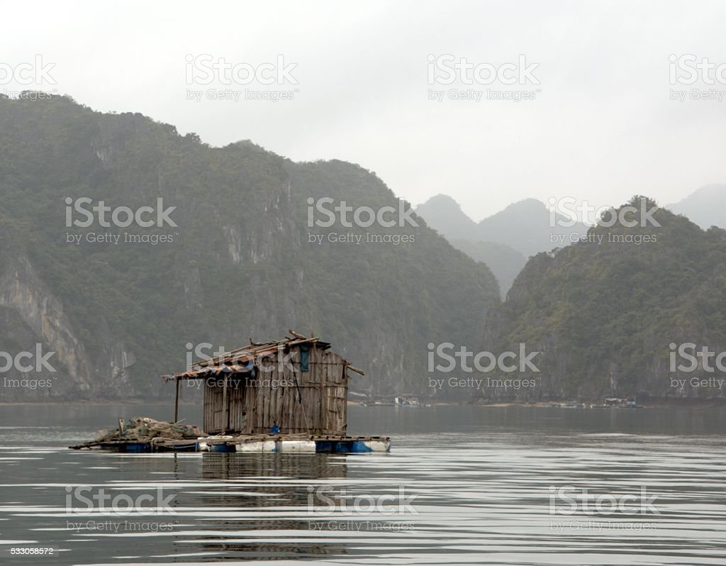 Floating house on Lan Ha Bay, Vietnam stock photo