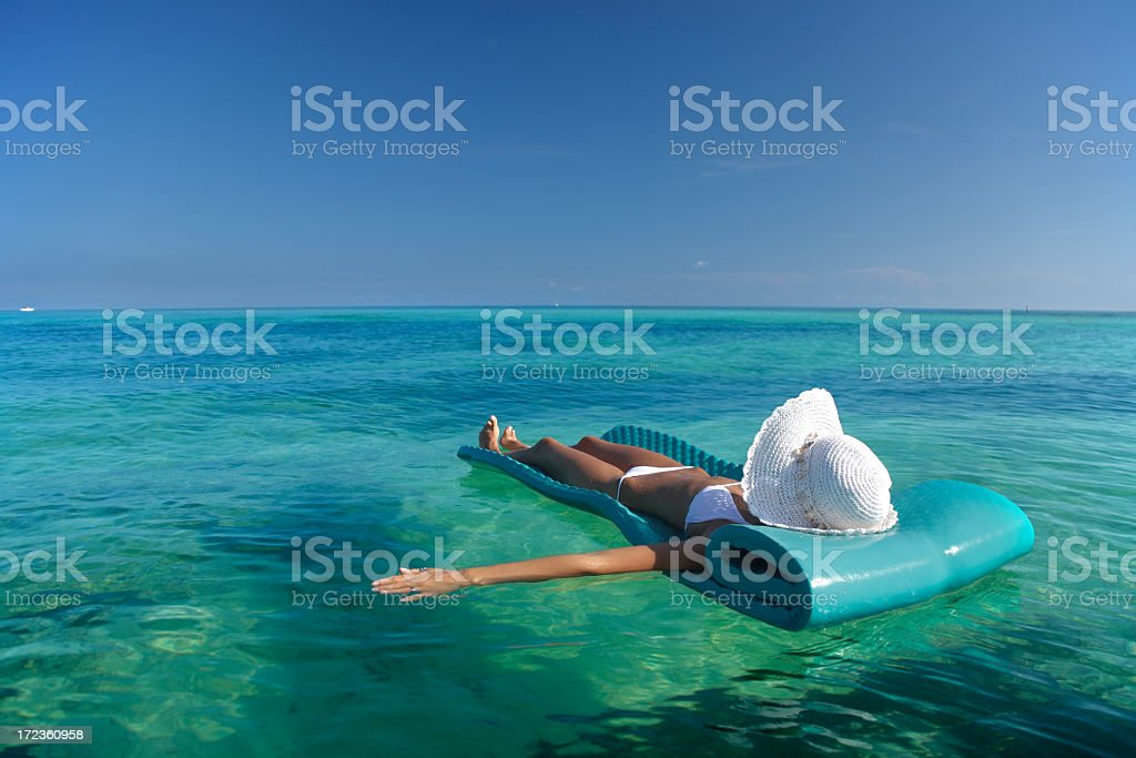 floating in the ocean stock photo