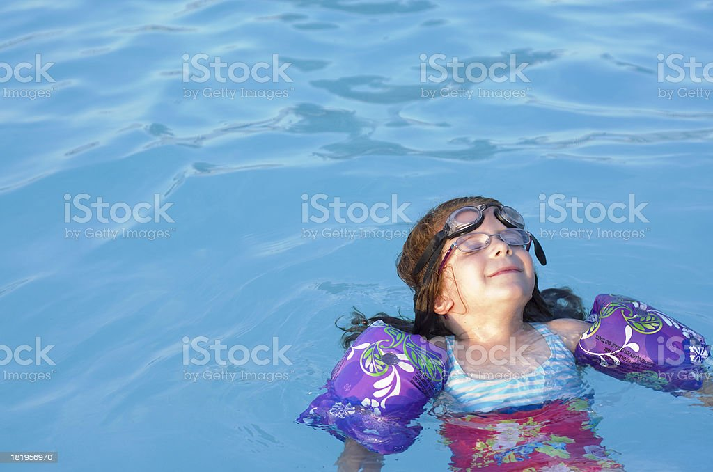 floating in the swimming pool royalty-free stock photo