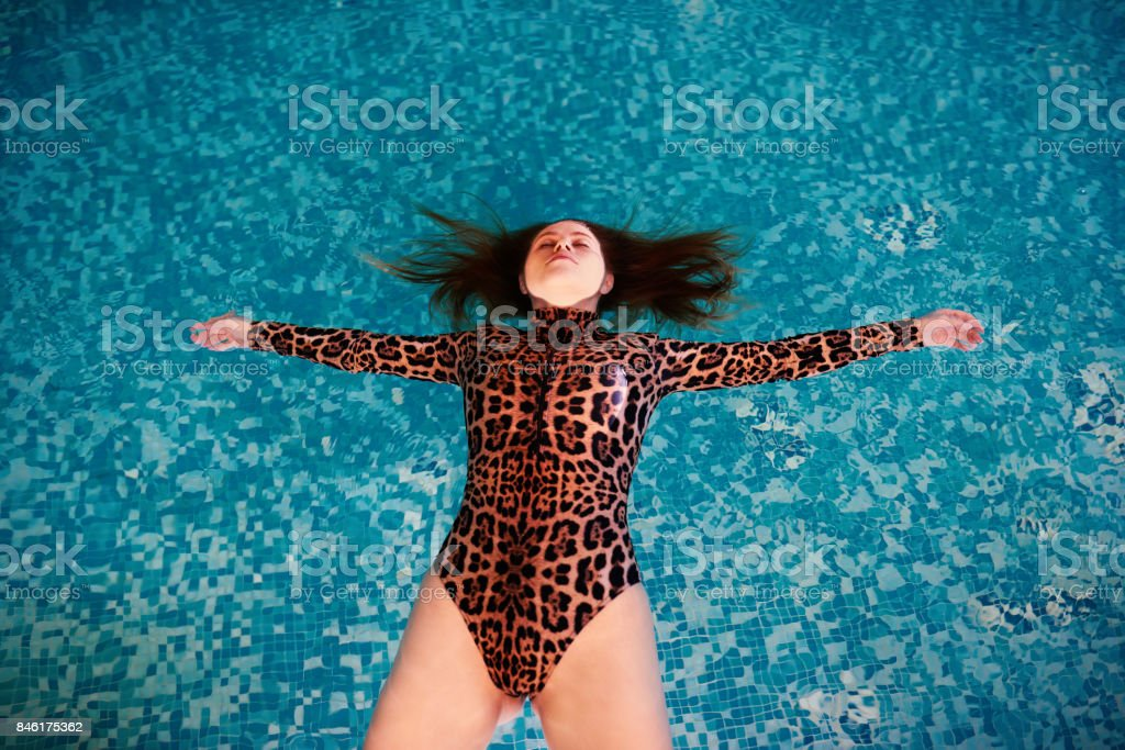 floating inside swimming pool stock photo