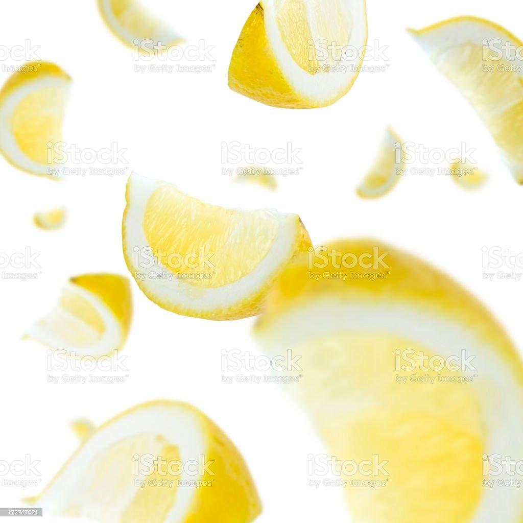 Floating lemon slices on white background royalty-free stock photo