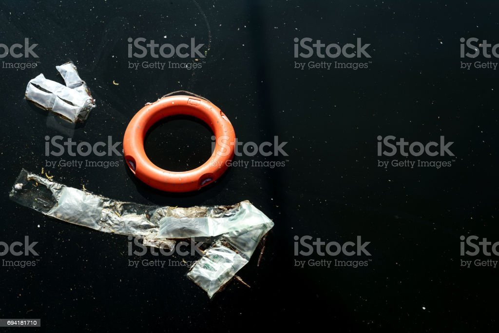 Floating Lifebouy and Rubbish stock photo