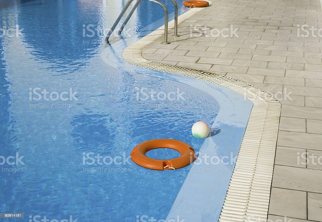 Floating lifebuoy on swimming pool stock photo