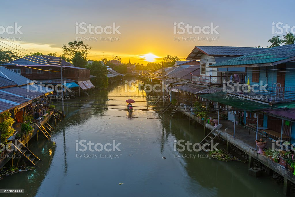 Floating market at sunrise in Amphawa, Samut Songkhram Province, stock photo