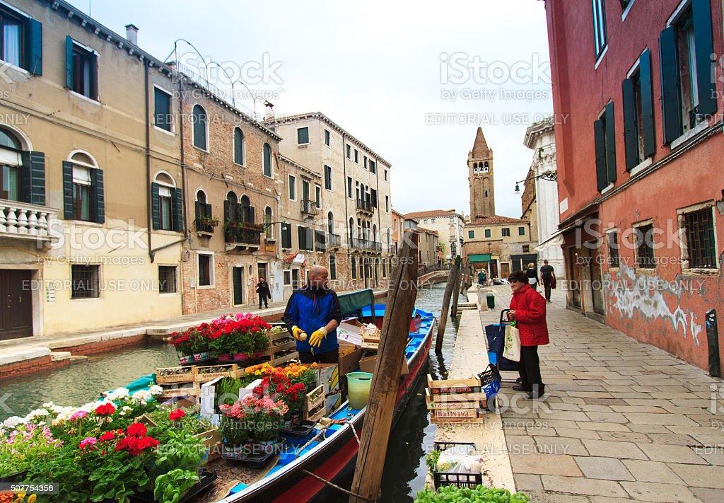 Floating Market, Canal, Senior Shopper in Venice, Italy stock photo