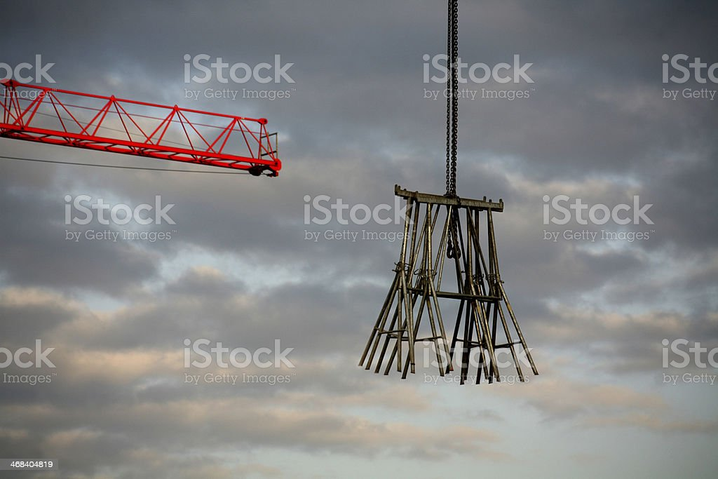Floating metal brackets to a construction crane stock photo