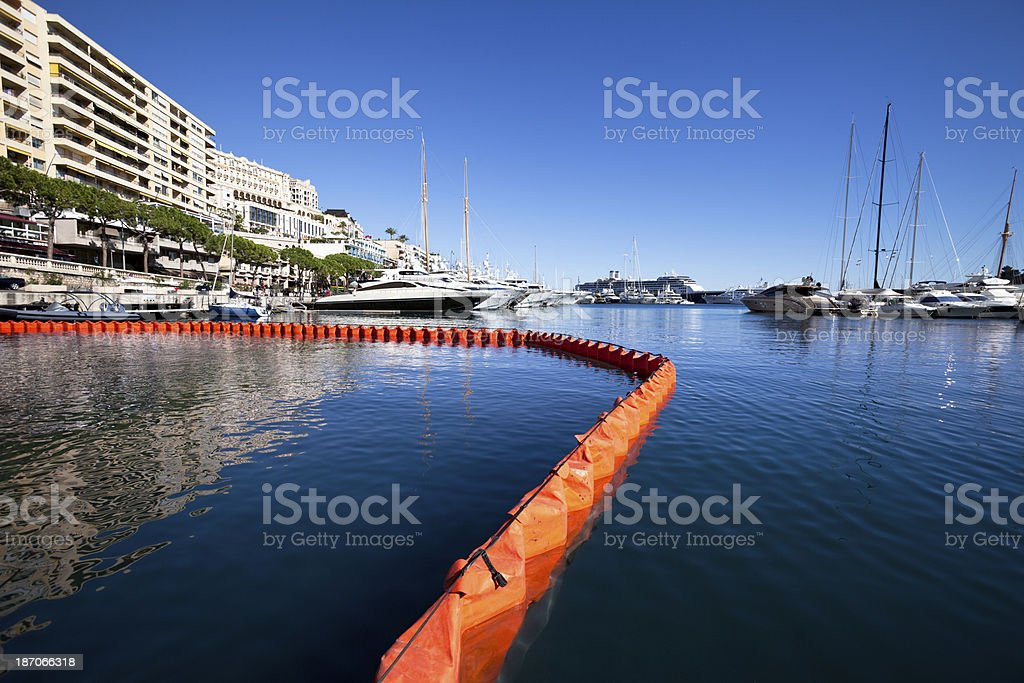 Floating Oil Pollution Boom Barrier in Harbor stock photo