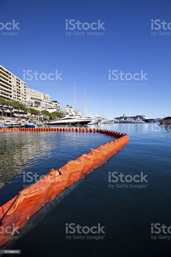 Floating Oil Pollution Boom in Yacht Harbor stock photo