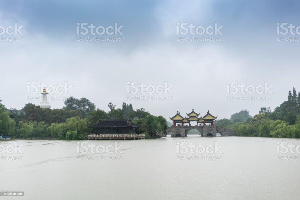 Floating on slender west lake on a rainy day stock photo