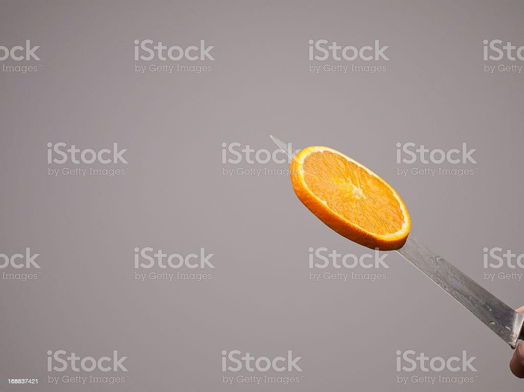 Floating orange slice royalty-free stock photo