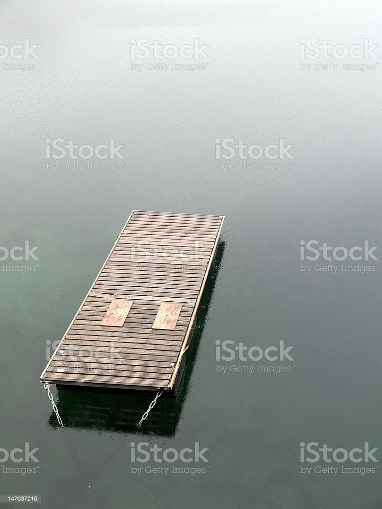 Floating pier in the rain royalty-free stock photo