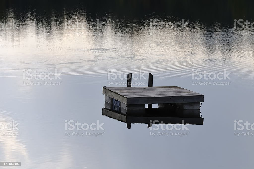 A floating raft in a lake in Michigan stock photo