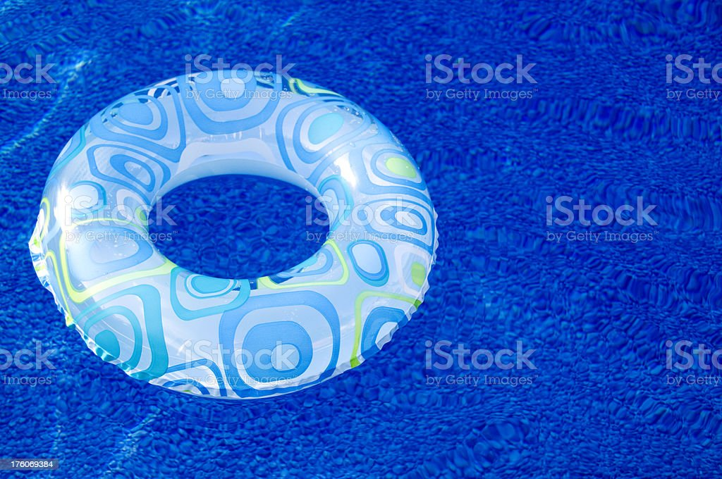floating ring on a blue swimming pool royalty-free stock photo