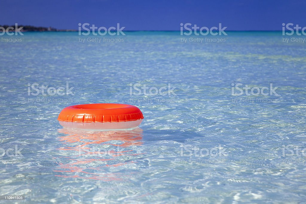 floating  ring on blue clear sea royalty-free stock photo