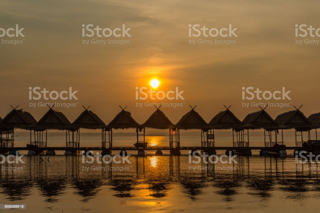 Floating Row of huts on the river. stock photo