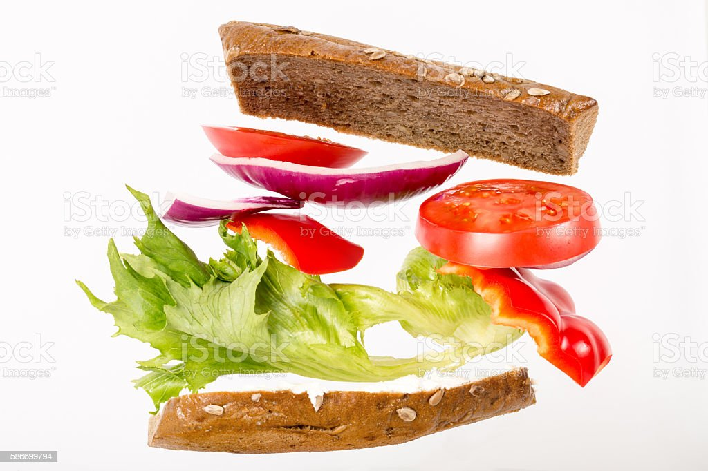 Floating sandwich with vegetables stock photo