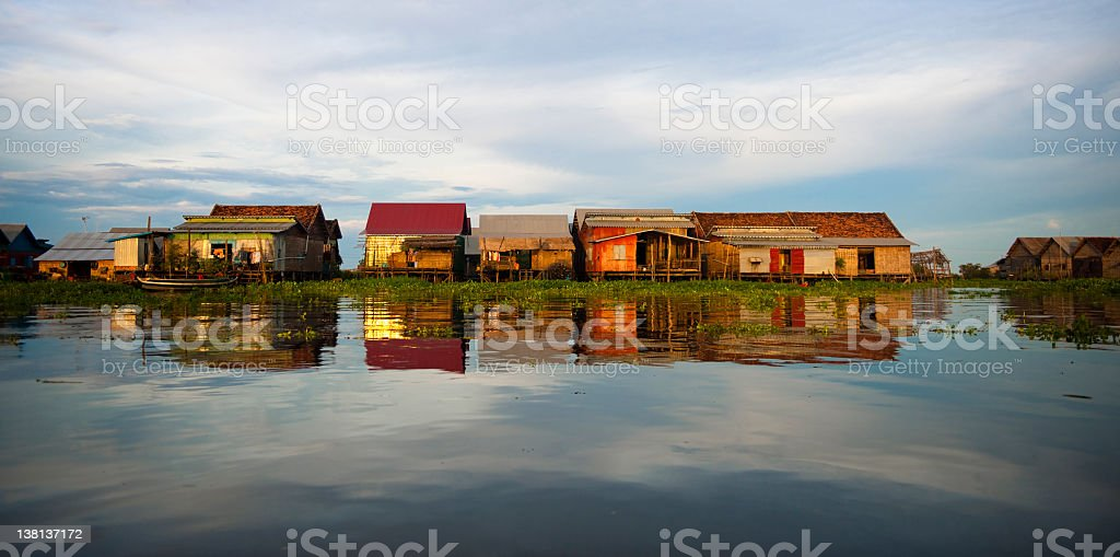 Floating shanty like Village on calm water stock photo