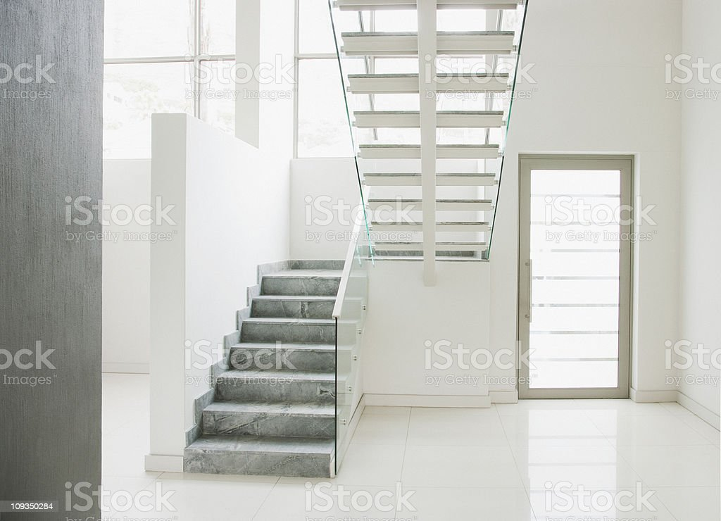 Floating staircase and glass walls in modern house royalty-free stock photo