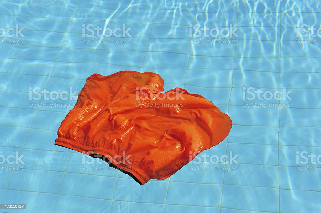 Floating swimming shorts in the pool stock photo