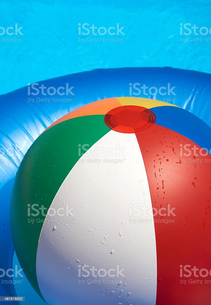 Floating tire and Beach Ball stock photo