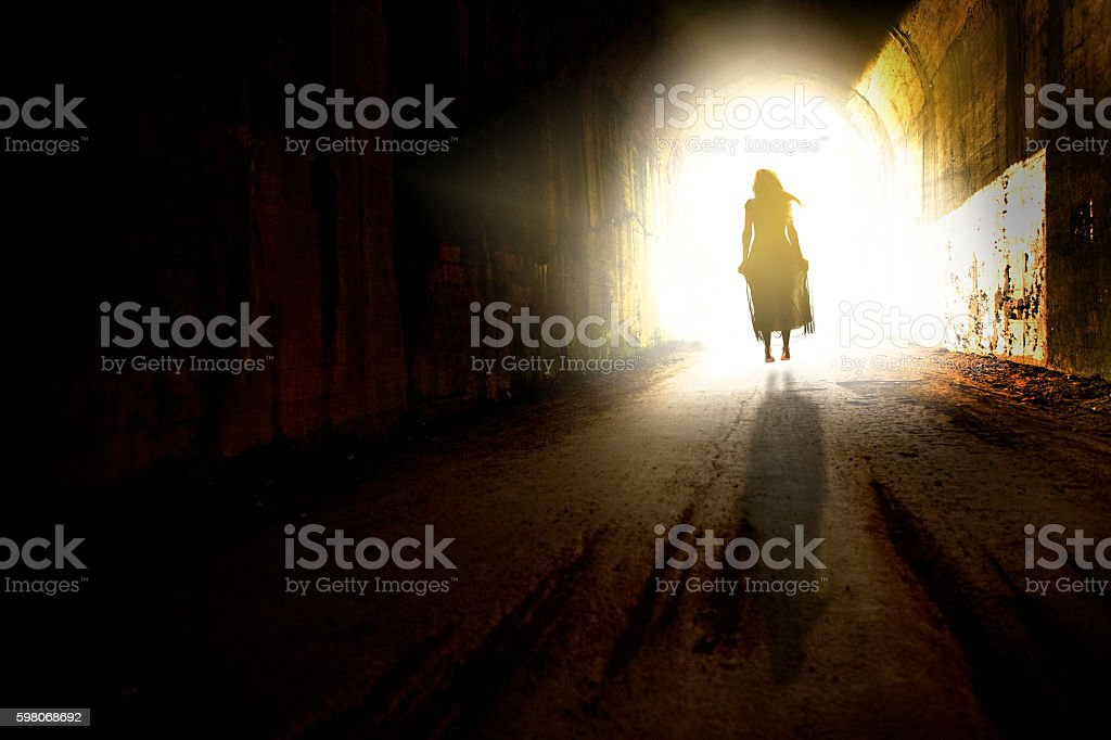 Floating To The Light In The Tunnel stock photo