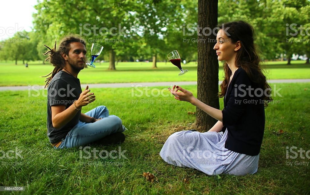 Floating wine glasses in the park stock photo