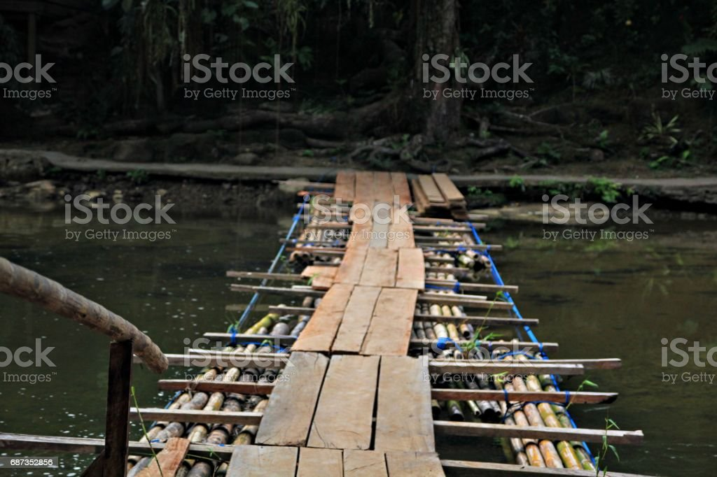 Floating wooden and bamboo bridge stock photo