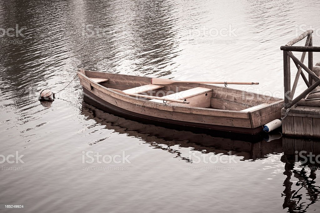 Floating Wooden Boat with Paddles royalty-free stock photo