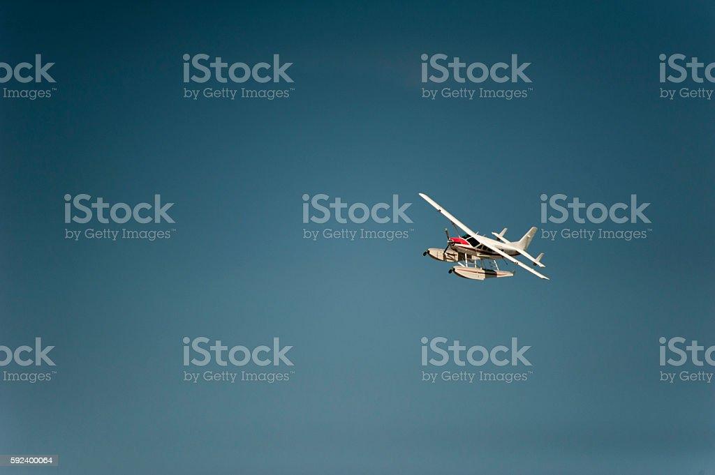 Floatplane flying blue sky stock photo