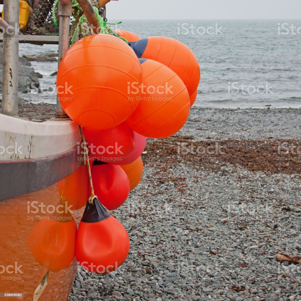 Floats on the side of a fishing vessel stock photo