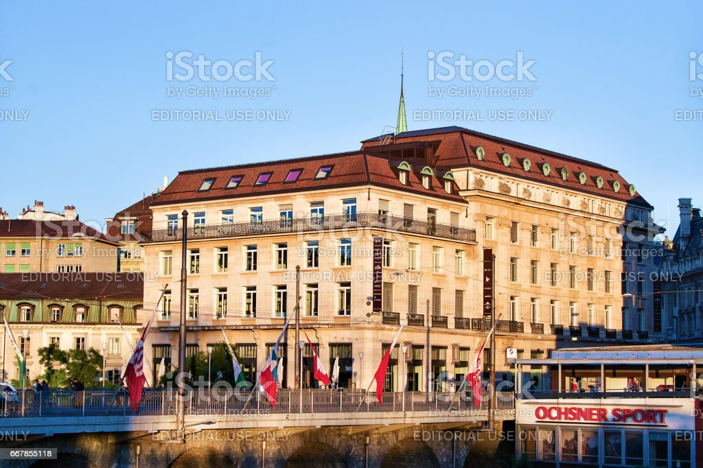 Flon district and Grand pont bridge with flags Lausanne stock photo