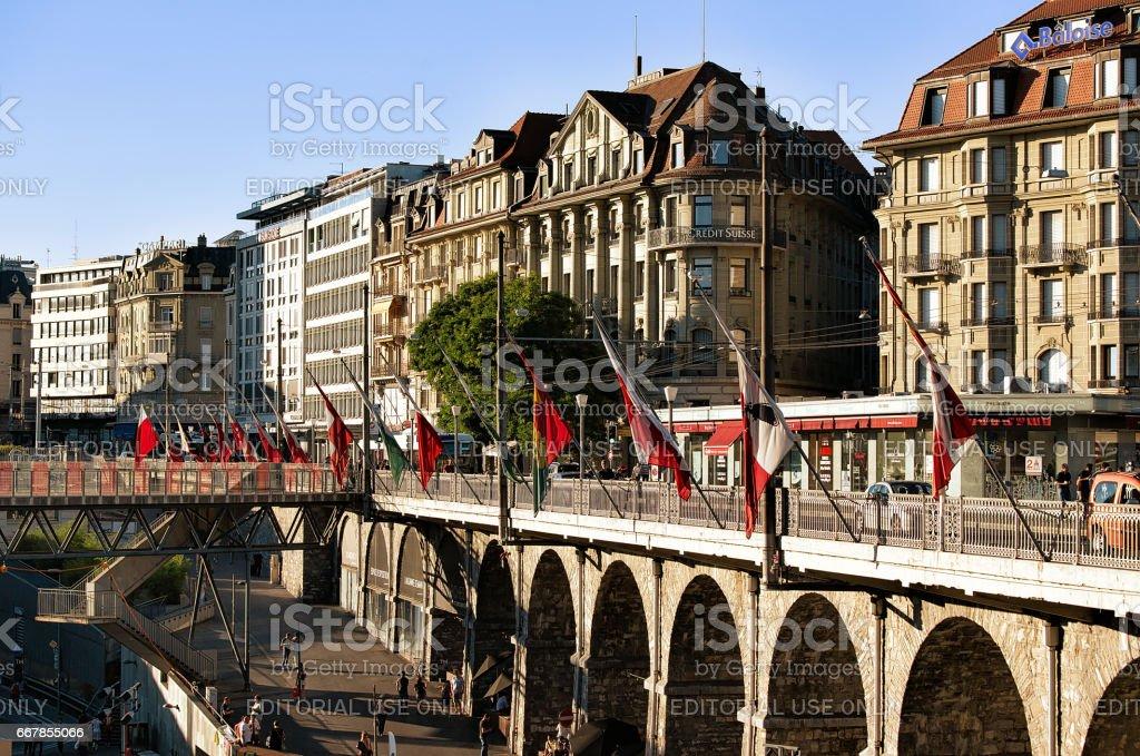 Flon district with Grand pont bridge with flags Lausanne stock photo
