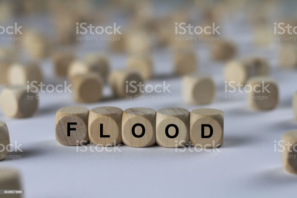flood - cube with letters, sign with wooden cubes stock photo