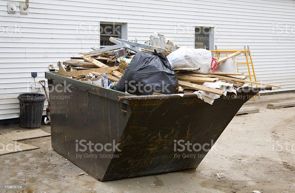 flood damage dumpster stock photo