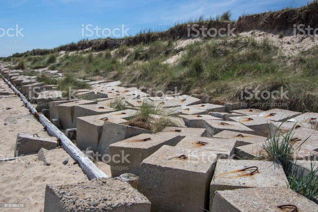 Flood defence measures. Concrete blocks protecting coastal cliffs. stock photo