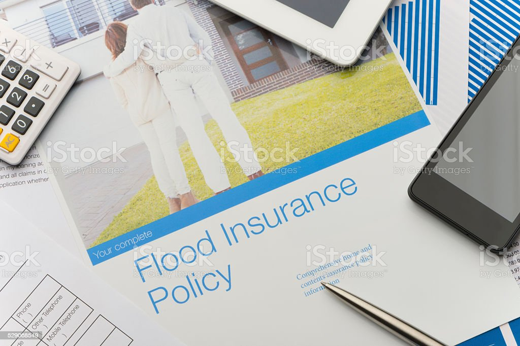 Flood insurance policy brochure with image of a couple stock photo