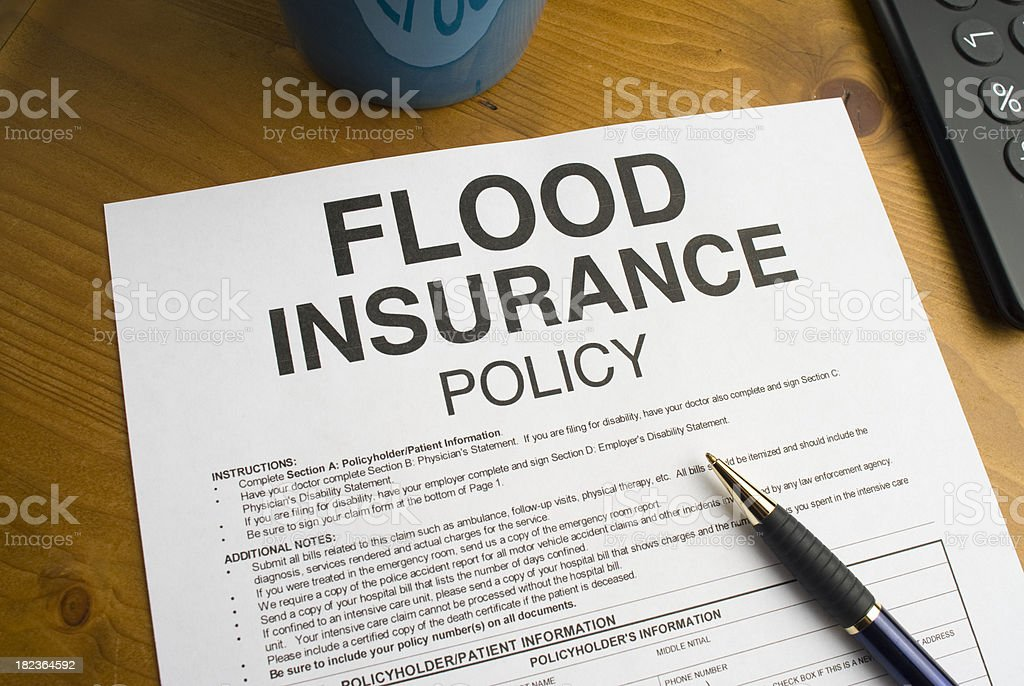 Flood Insurance Policy on a desktop royalty-free stock photo
