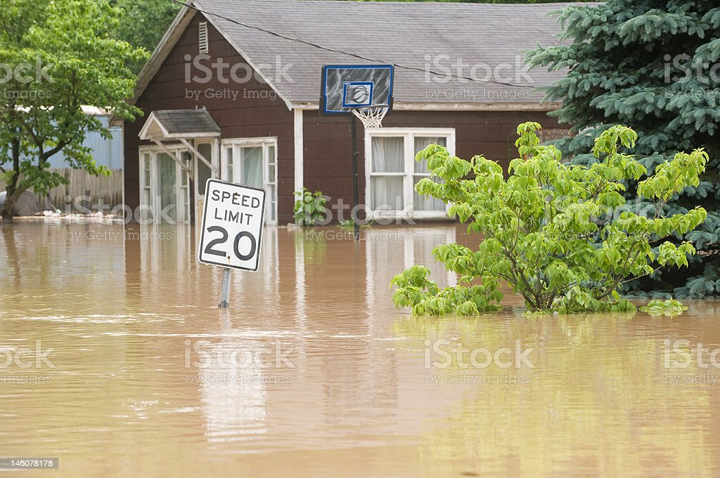 Flood waters in an Indiana town with flooded homes stock photo