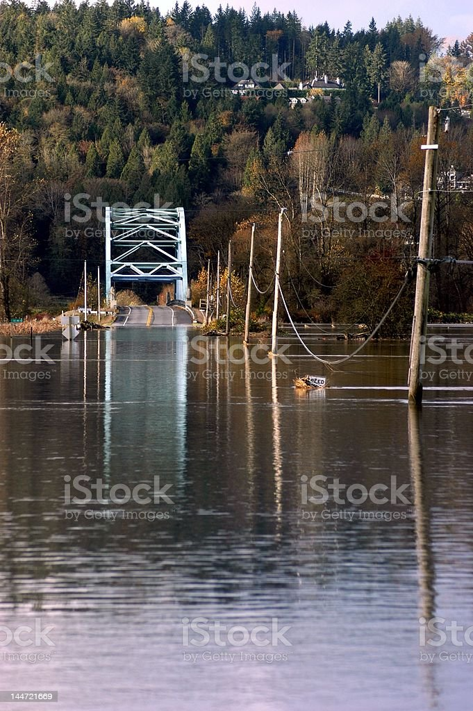 Flood waters over roadway stock photo