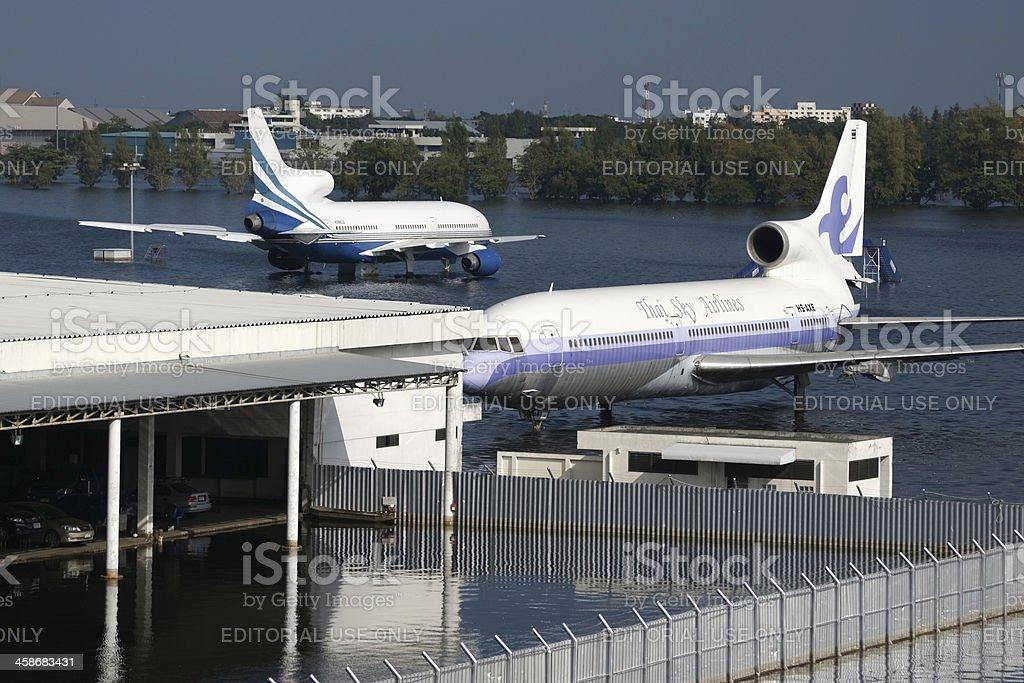 Flooded Airplane at Airport Bangkok, Thailand royalty-free stock photo