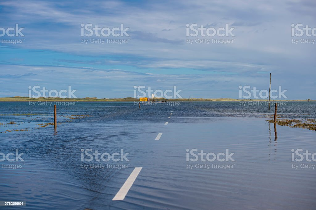 Flooded causeway to Holy Island and Lindisfarne in Northumberland stock photo
